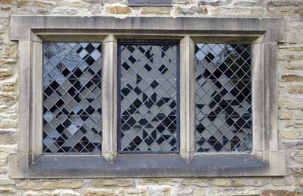 Golden Honey Stacked Stone around a stained glass window ... |Stone Glass Window
